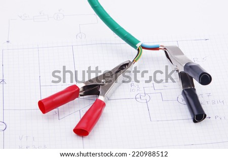 Electric clamps and electric cable on a background of the electric scheme