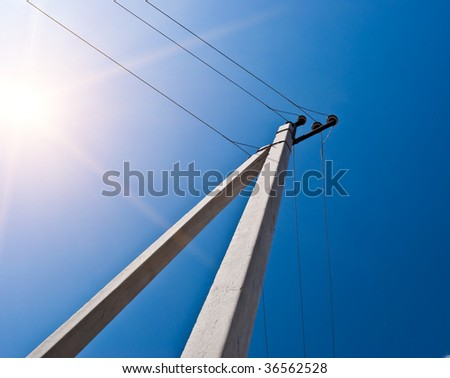 Electric column against the blue sky - stock photo