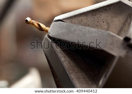 Electric drill head with drill bit on background - stock photo