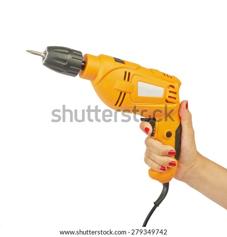 Electric drill in her hands isolated on white background - stock photo