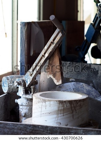 electric drive rotating wheel for jiggering or throwing production process for craft and industrial ceramic in education training with a plaster mold and metal jiggering arm - stock photo