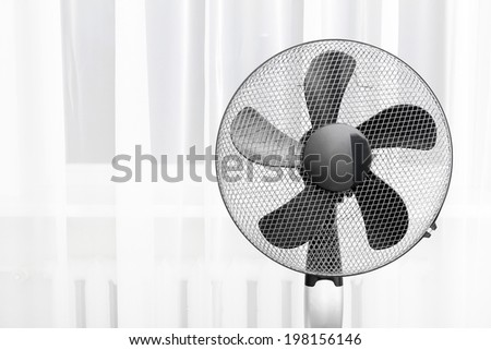 electric fan in the room - stock photo