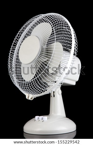 Electric fan on black background - stock photo