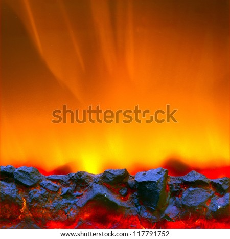 Electric fireplace with a burning coals and red-orange background - stock photo