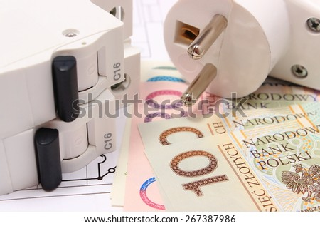 Electric fuse and plug with money on electrical construction drawing of house, accessories for engineering work, concept for energy saving - stock photo