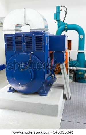 Electric generator in a small hydro power plant. - stock photo