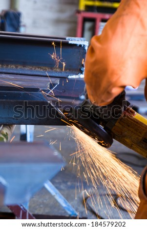 Electric grinding wheel with steel construction in metal work factory - stock photo