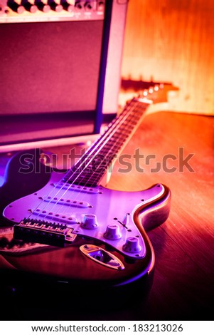 Electric guitar and amplifier - stock photo