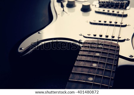 Electric guitar. Detail, selective focus . Shallow depth of field. Music, learning how to play the guitar and abstract concept - stock photo