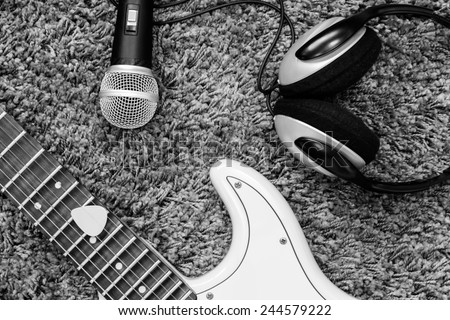 electric guitar , headphone & dynamic microphone / black and white processed - stock photo