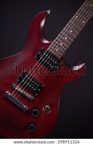 Electric guitar mahogany on a gray background - stock photo