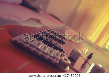 Electric guitar old wooden surface vintage style - stock photo