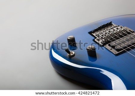 Electric guitar on grey background - stock photo
