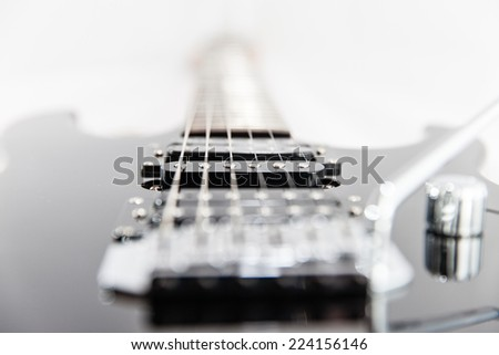 Electric Guitar strings and pickup closeup - stock photo