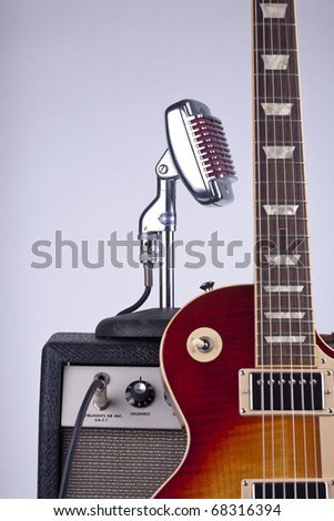 Electric guitar with amplifier and microphone - stock photo