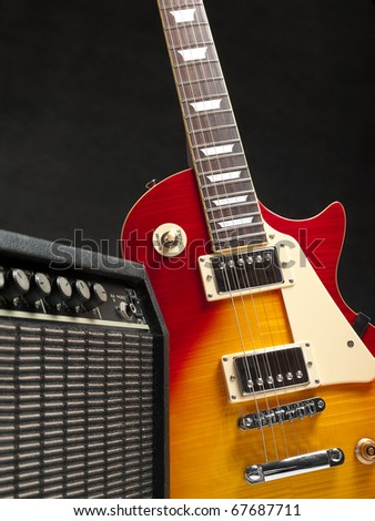 electric guitar with amplifier, for music and entertainment themes - stock photo