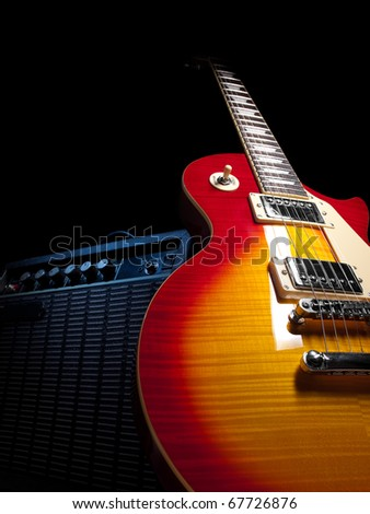 electric guitar with amplifier,over black background,  for music and entertainment themes - stock photo