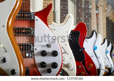 Electric guitars hanging on wall - stock photo