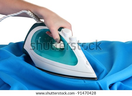 Electric iron on blue cloth isolated on white - stock photo