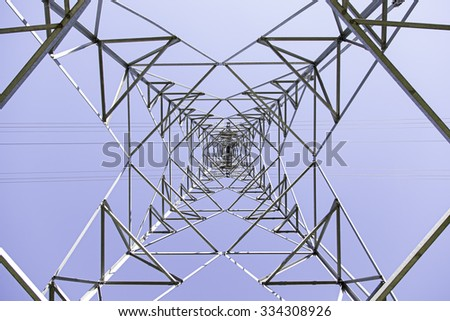 Electric iron tower on city street, industry - stock photo