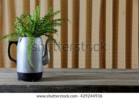 Electric Kettle old application as potted plants on wooden table. - stock photo