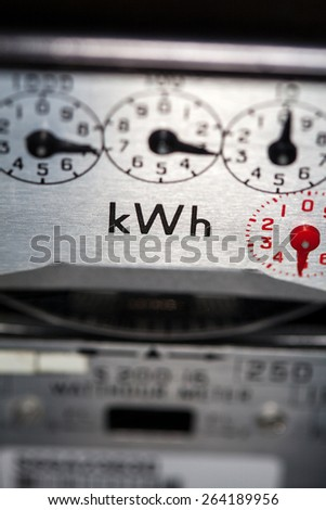 Electric meter dials close-up - stock photo
