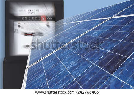 Electric meter with solar panel against blue background, close up. - stock photo