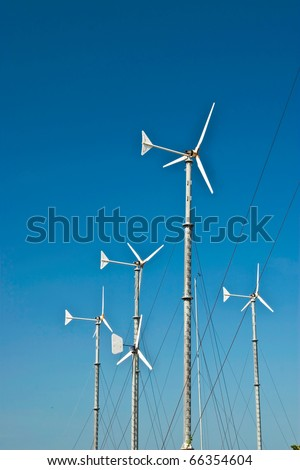 Electric mills on blue sky