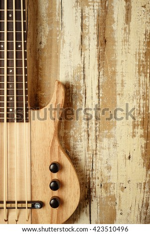 electric mini bass guitar on aged wood,music background