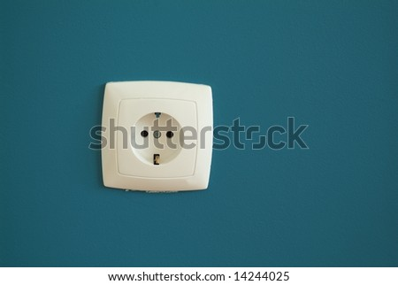 Electric outlet on blue gray background