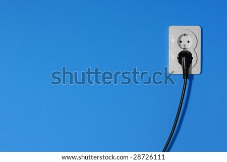 Electric outlets on a blue wall - stock photo
