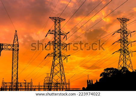 electric pillars on sunset background  in thailand - stock photo