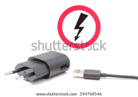 Electric plug and cable for electrical appliances and high voltage danger sign in background, electrical symbol. Isolated on white background - stock photo