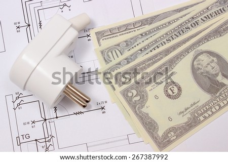 Electric plug and money on electrical construction drawing of house, accessories for engineering work, concept for energy saving - stock photo