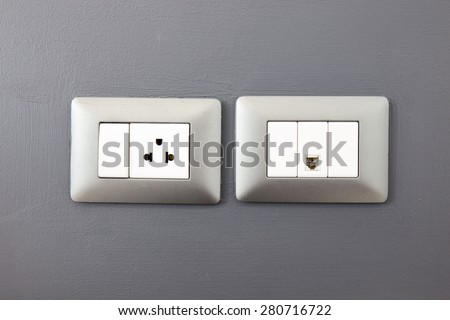 electric plug and network ethernet port on wall - stock photo
