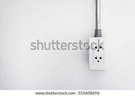 Electric plug cement wall background - stock photo