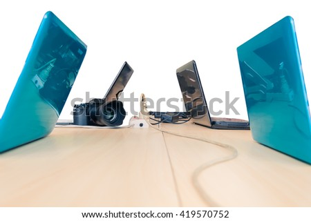 Electric plug with laptop and camera in white background - stock photo