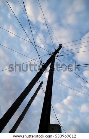 electric pole in the sun dawn