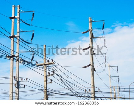 Electric pole with blue sky - stock photo