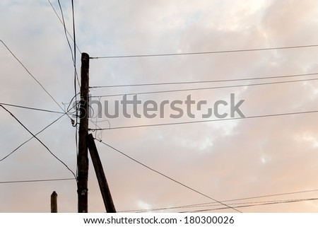 electric pole with wires at sunset