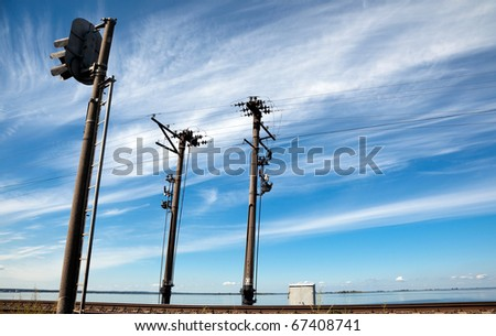 Electric poles along the railroad on natural background. - stock photo