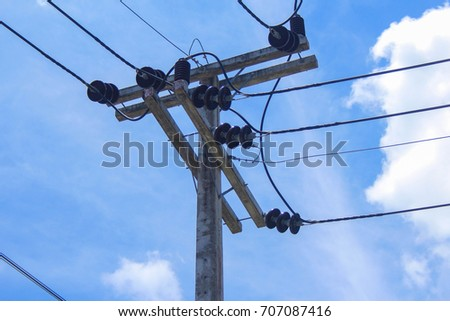 Electric poles and blue skies
