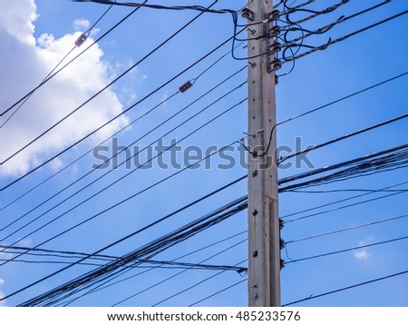 electric post with blue sky and clouds in sunny day