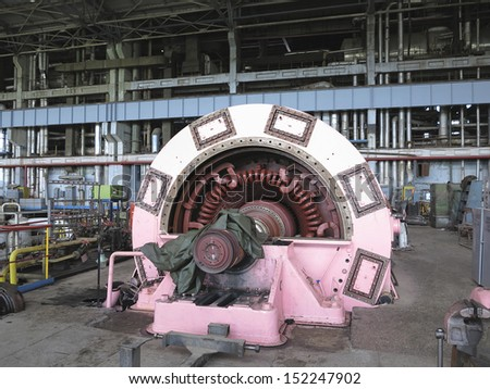 Electric power generator and steam turbine during repair at power plant - stock photo
