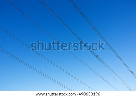 Electric power lines abstract formations on blue sky. in Hong Kong