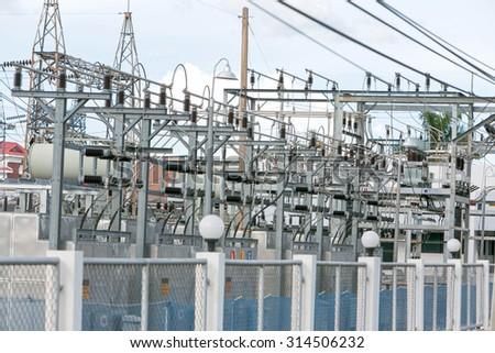 Electric Power-plant transformer station area. - stock photo
