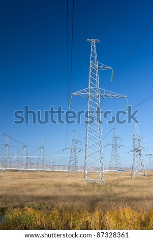 Electric Power Pylon, Power Lines and Power Station on the background - stock photo