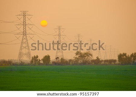 Electric power station in the field on sunset - stock photo