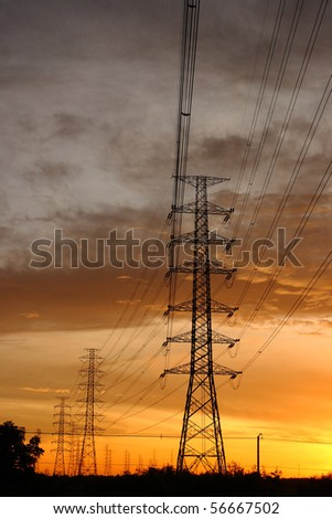 Electric power station in the sunset - stock photo