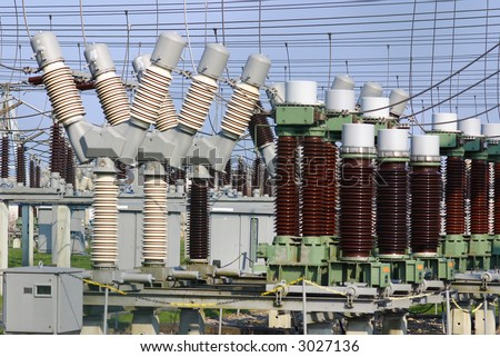 Electric power transformation substation with blue sky - stock photo